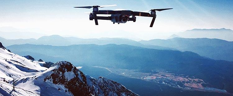 The DJI Mavic Air 2 flying over mountains sidh udush dhiei duaid